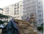 De la paille pour l'isolation par l'extérieur d'un immeuble de ParisHabitat